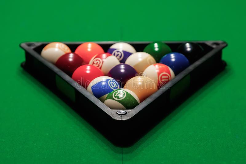 Billiard ball in the triangle on the billiard table, American billiards. Sports games, outdoor activities.  stock images