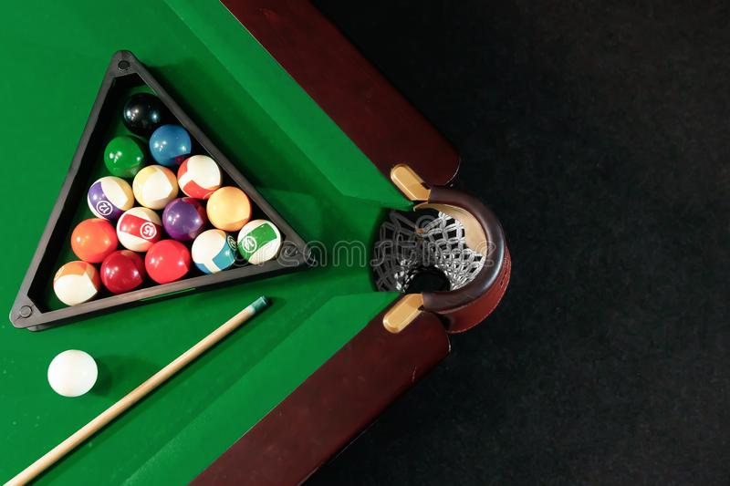 Billiard ball in the triangle on the billiard table, American billiards. Sports games, outdoor activities.  royalty free stock image