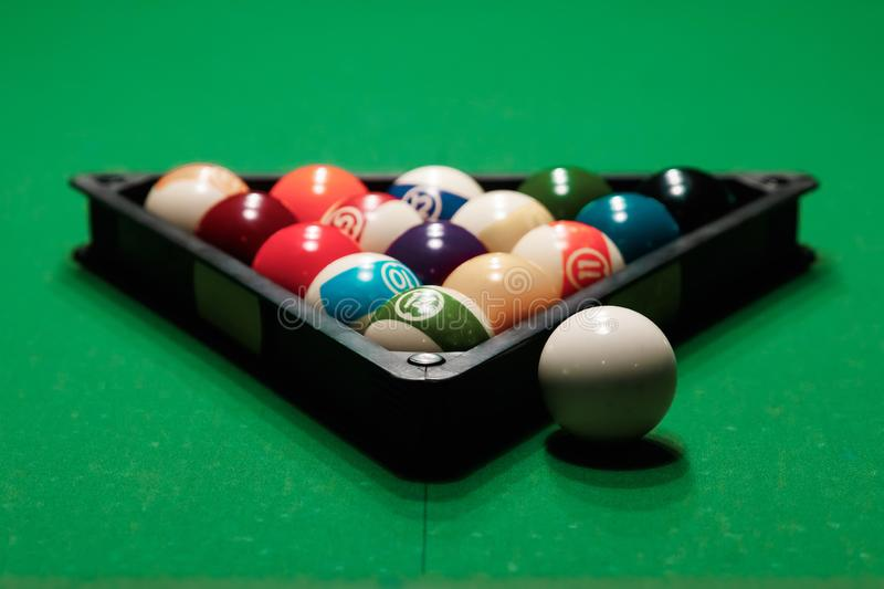 Billiard ball in the triangle on the billiard table, American billiards. Sports games, outdoor activities.  stock image