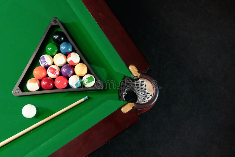 Billiard ball in the triangle on the billiard table, American billiards. Sports games, outdoor activities.  royalty free stock images
