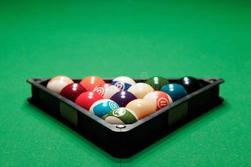 Billiard ball in the triangle on the billiard table, American billiards. Sports games, outdoor activities.  royalty free stock photography