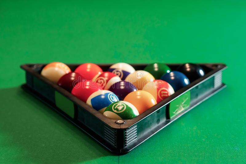 Billiard ball in the triangle on the billiard table, American billiards. Sports games, outdoor activities.  royalty free stock photo