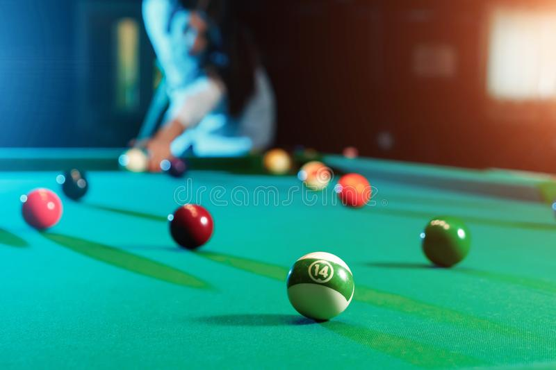Billiard balls on the billiard table, American billiards. Sports games, outdoor activities.  royalty free stock photo