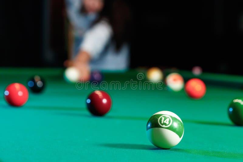 Billiard balls on the billiard table, American billiards. Sports games, outdoor activities.  stock photo