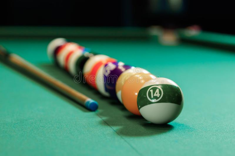Billiard balls are lined up on a billiard table, American billiards. Sports games, outdoor activities.  stock images