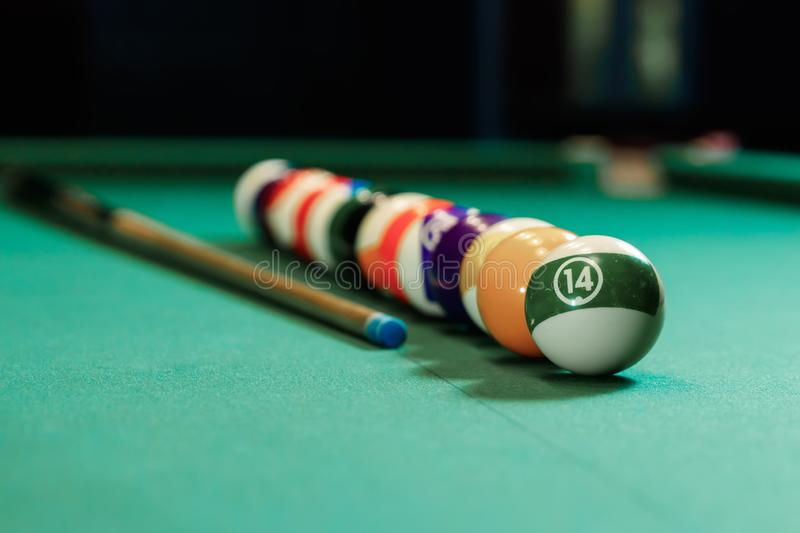 Billiard balls are lined up on a billiard table, American billiards. Sports games, outdoor activities.  royalty free stock photo