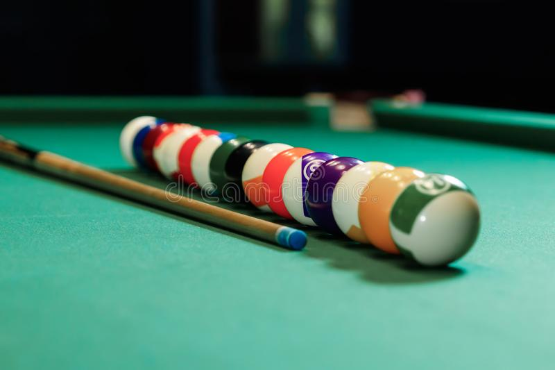 Billiard balls are lined up on a billiard table, American billiards. Sports games, outdoor activities.  stock photography