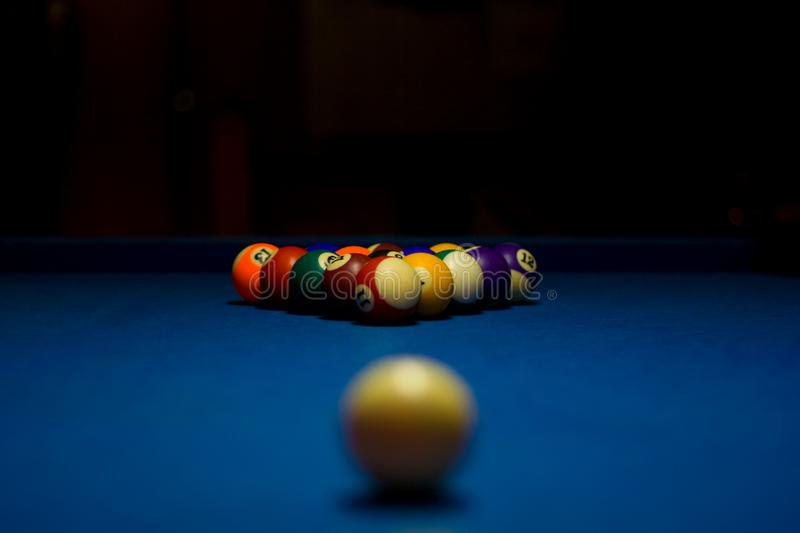 Billiard balls with white ball. Out of focus stock images