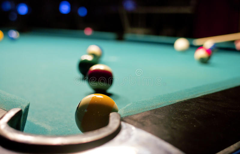 Billiard game on pool table royalty free stock image
