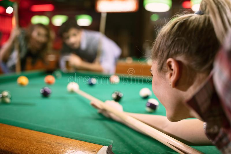 Billiard player aiming on billiard table. Billiard girl player aiming on billiard table stock image