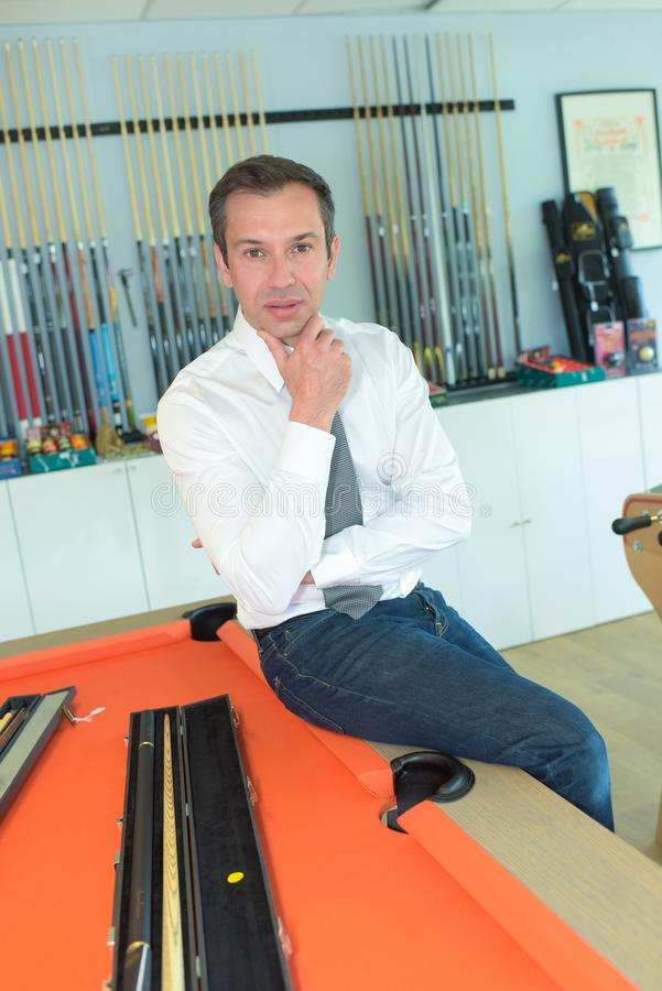 Billiard player looking at camera royalty free stock photography