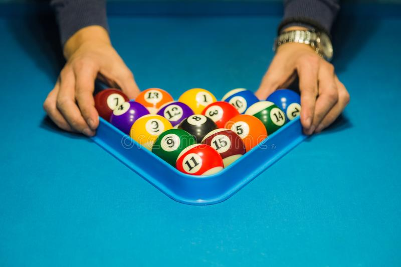 Close up of man hands holding triangle frame with billiard pool stock images