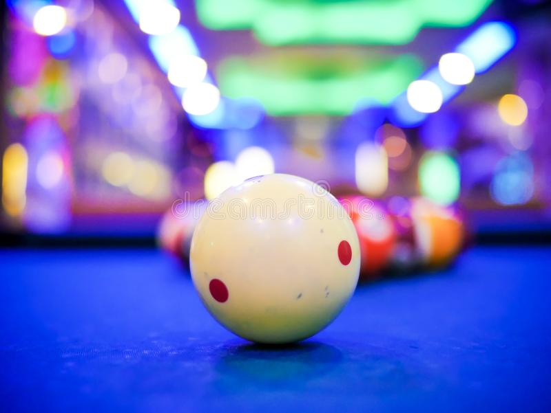 Billiard snooker white ball number close up on pool blue table. Close up royalty free stock image