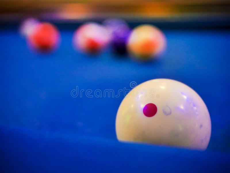 Billiard snooker white ball number close up on pool blue table. Close up royalty free stock photo