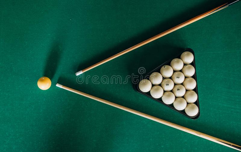 Billiard table green velvet two cue balls. Billiard table with green velvet two cue and balls, russian, felt, number, leisure, gamble, sphere, stick, bar stock image