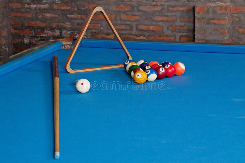 Billiards. billiard balls and cues on blue table stock photo