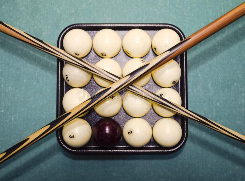 Billiards, billiard table, balls and cue. Balls in the tray and stock photo