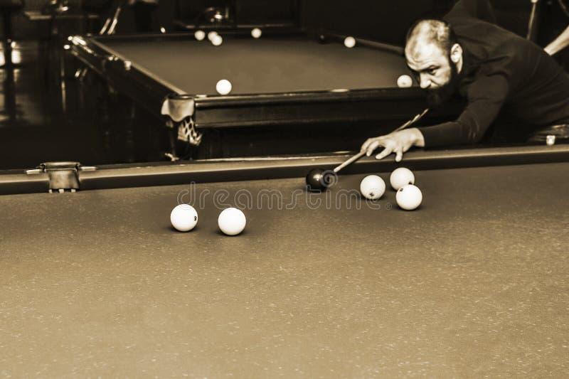 Billiards player in the club Premier, Russia, Kursk region, Zheleznogorsk, December 2017 stock image