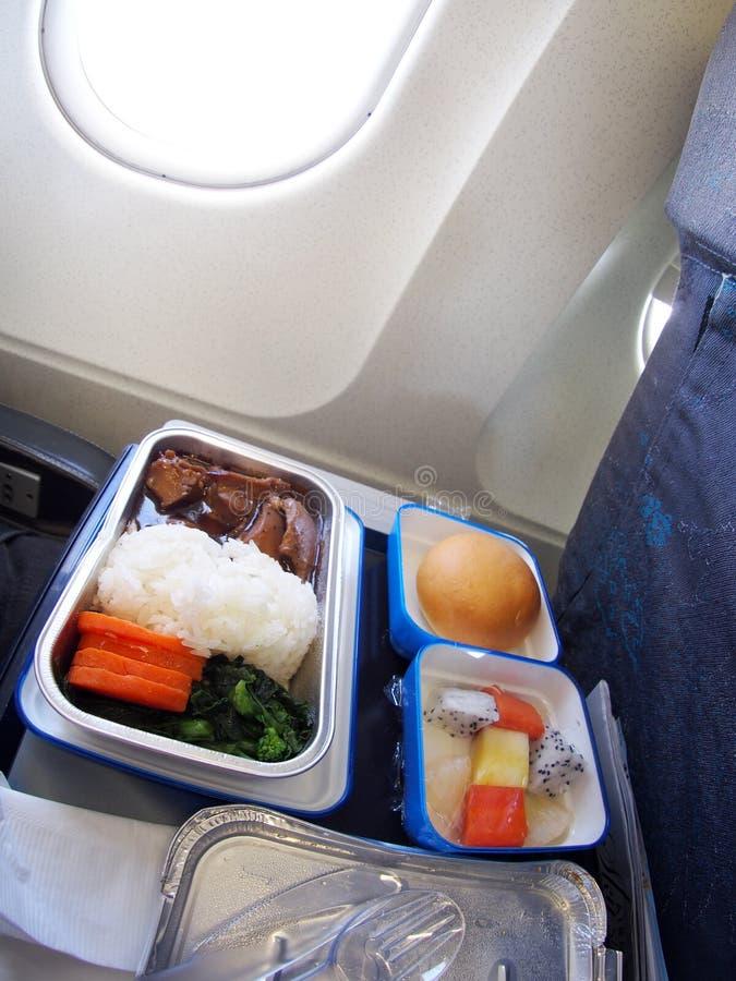 Billig meny för passagerare för low costekonomiklassflygplan arkivbilder