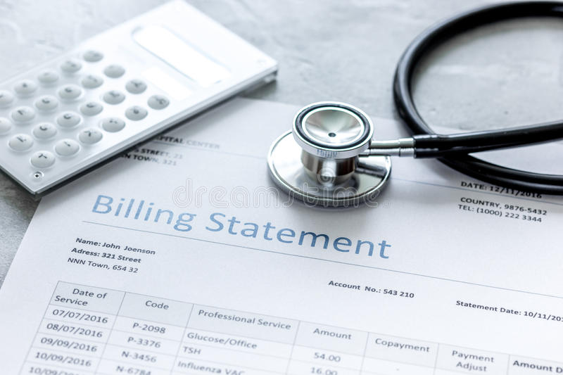 Billing statement for for medical service in doctor`s office background stock photo