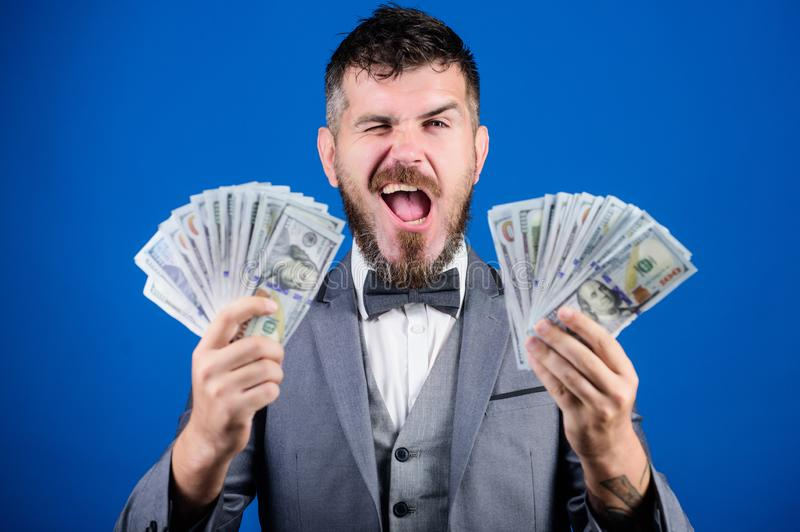 Billioner with dollar banknotes. Business and sport success. winning a lottery. businessman after great deal. Finance royalty free stock photography