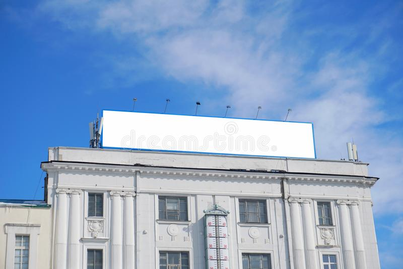 Billlboard for an advertise with the blue sky. royalty free stock photography