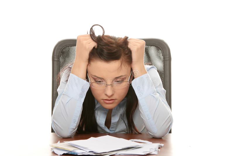 Bills. Young woman depressed because of bills - bankruptcy concept stock photo