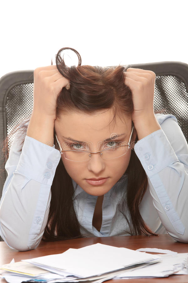 Bills. Young woman depressed because of bills - bankruptcy concept royalty free stock photos