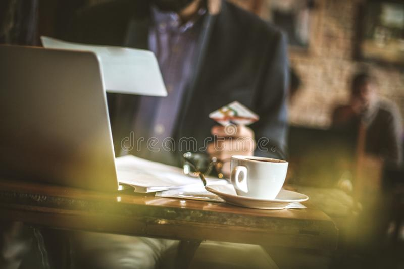 Bills, accounts and banks. Young business checking online. Close royalty free stock photography