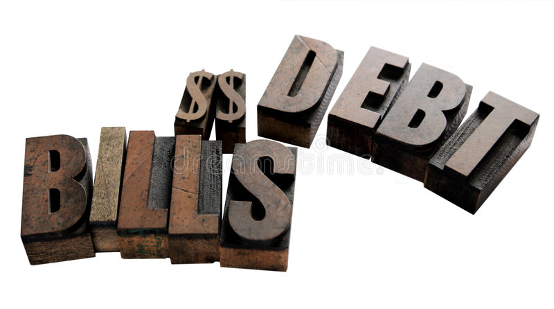 Bills, dollar signs, debt. The words 'bills' and 'debt' with two dollar signs in wood type royalty free stock images