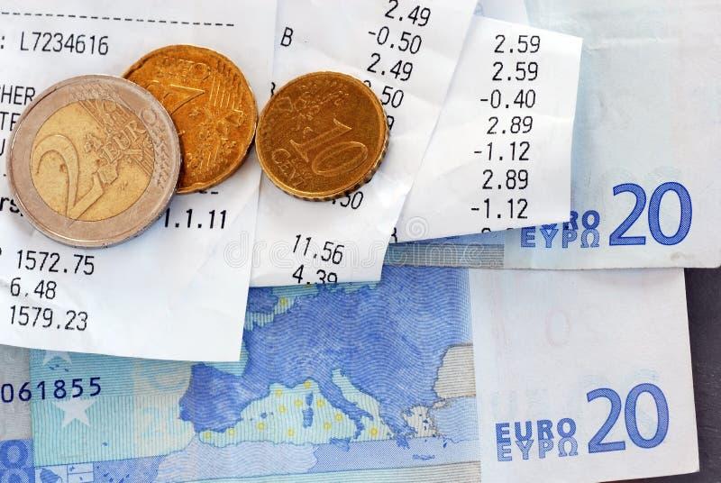 Bills and money. Closeup of bills and euro banknotes and coins macro royalty free stock images