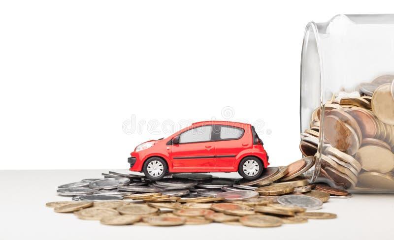Bilmodell med mynt royaltyfri foto