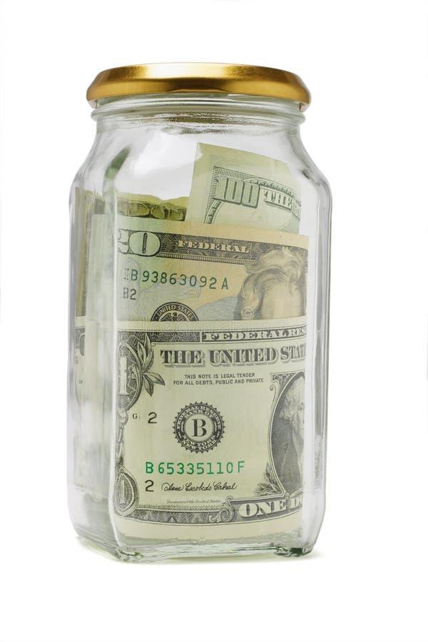 Bils de dólar americano en el envase de cristal imagenes de archivo