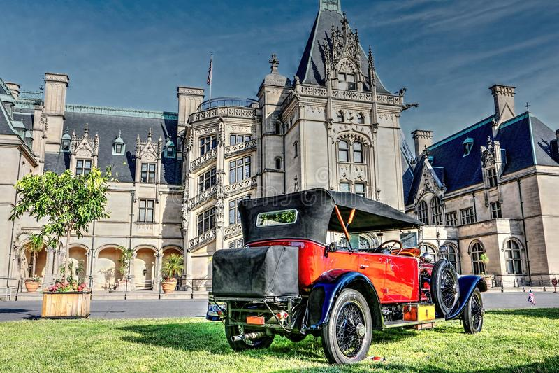 Biltmore And Antique Rolls-Royce. Beautiful Spring day on the Biltmore estate could not get any better than this! Antique Rolls-Royces and Bentleys sit in front stock photos