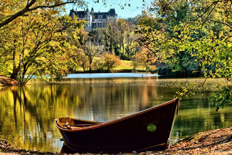 Biltmore Autumn And Orvis Rowboat. Autumn in full swing at the Biltmore lagoon. For those of you who have never been to Asheville North Carolina the Biltmore royalty free stock photography