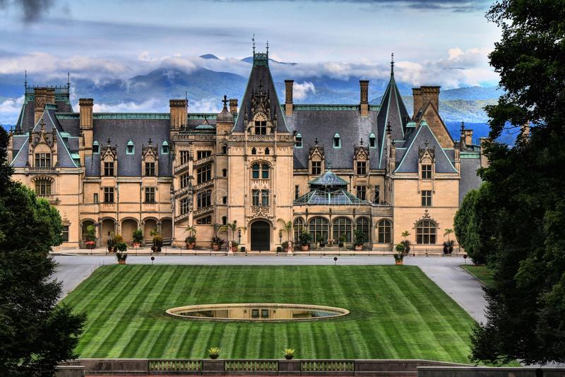 Biltmore House in Foreground of Blue Ridge Mountians. As morning fog lefts the mountains of Western North Carolina begin to peek through. George Vanderbilt with royalty free stock photo