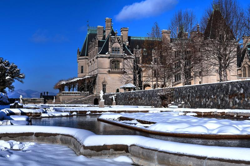 Biltmore Italian Garden Covered In Snow. December snowfall creates a winter wonderland on the Biltmore estate. The Italian gardens and koi pond covered in snow stock image