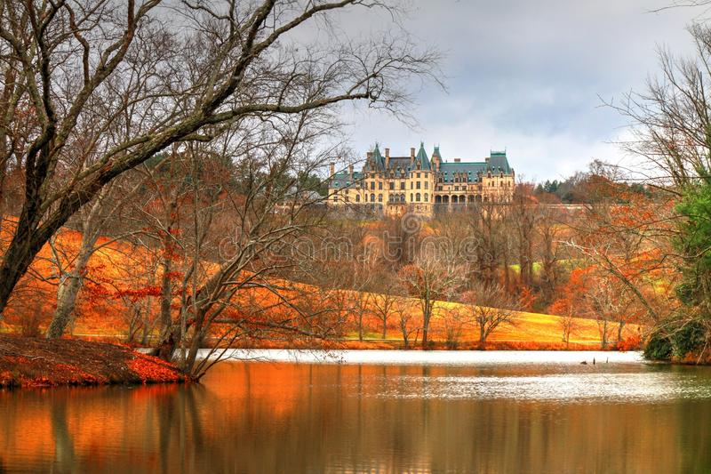 Biltmore Lagoon Color. A little color on the trees and ground the Biltmore house still show its beauty! My love affair grows with the Biltmore estate, located in stock photos