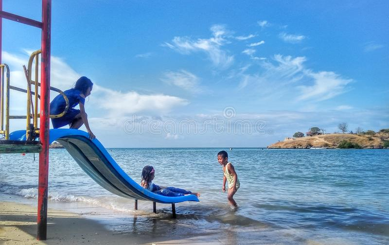 Bima, West Nusa Tenggara, Indonesia. July 3 2018 : Children play on the beach during summer vacation. royalty free stock images