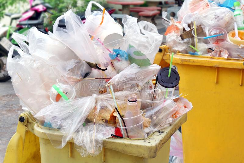 Bin, Dump Garbage, Plastic waste, Pile of Garbage Plastic Waste Bottle and Bag Foam tray many on bin yellow, Plastic Waste stock photography