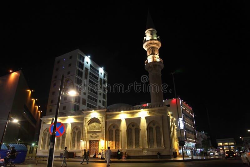 Bin Laden mosque nearby Balad Shopping area at night in Jeddah, Saudi Arabia royalty free stock image