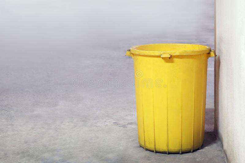 Bin plastic yellow color old for waste dump, empty bin for garbage waste on floor, dirty bin plastic, trash bin for recycle waste royalty free stock images