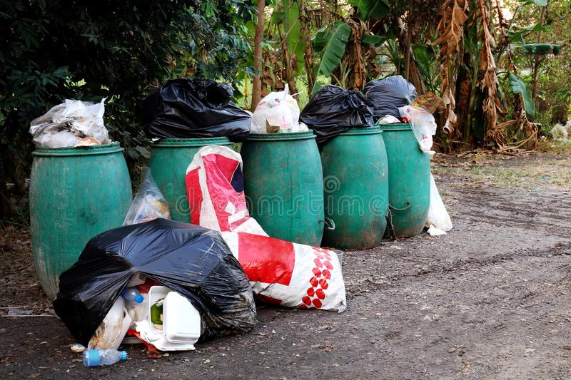 Bin, Bin trash and many pile of garbage bags on the ground, Bin waste plastic for recycle garbage, Waste many, Pollution waste royalty free stock photography