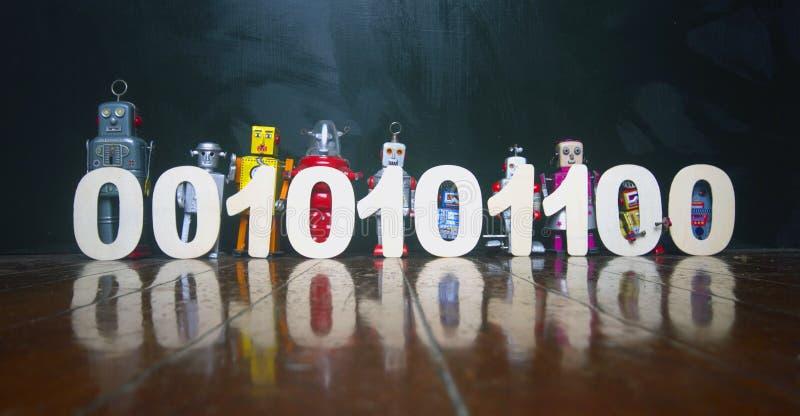Binaire die kabeljauw door een lijn van uitstekend robotspeelgoed wordt gehouden op een houten floo stock afbeelding
