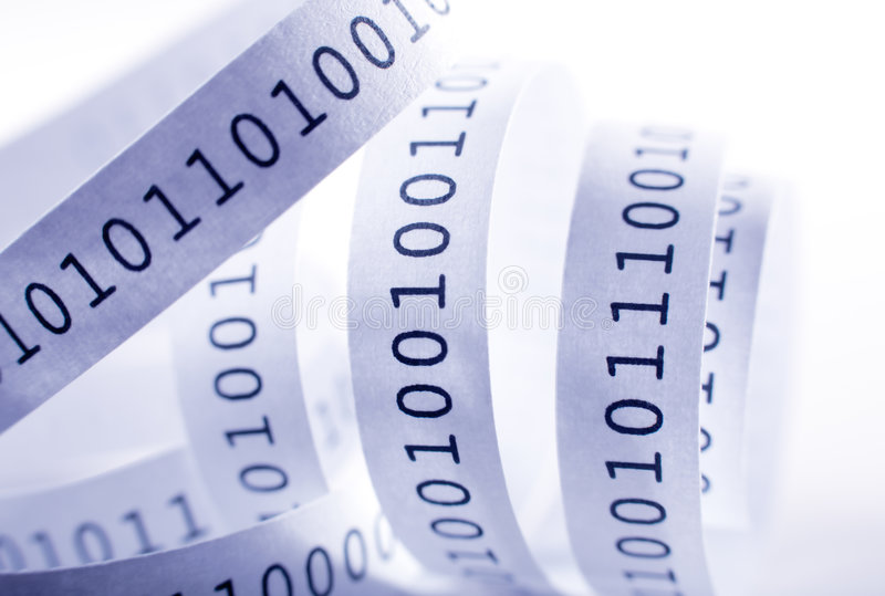 Binary code. Tape with binary code close-up. Shallow DOF stock photos