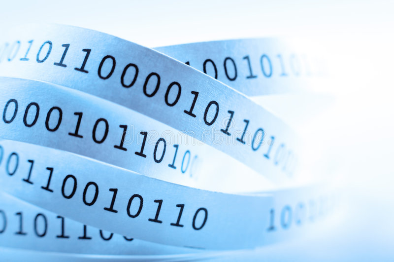Binary code. Tape with binary code close-up. Shallow DOF. Blue tone stock photography