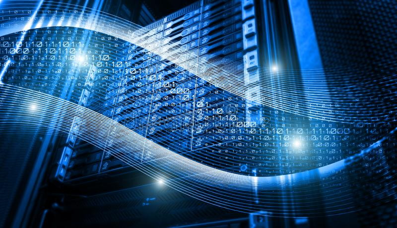 Binary code data flow inside server array. Blue tone binary code data flow inside server array. Digital information stream in disk storage. Abstract future royalty free stock photos