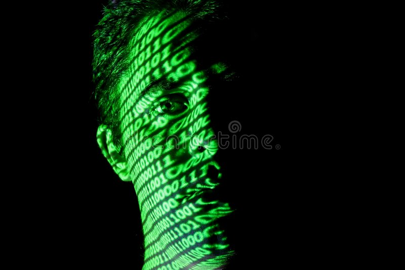 Binary Face 1. Binary code Projected onto a Man's face royalty free stock photography