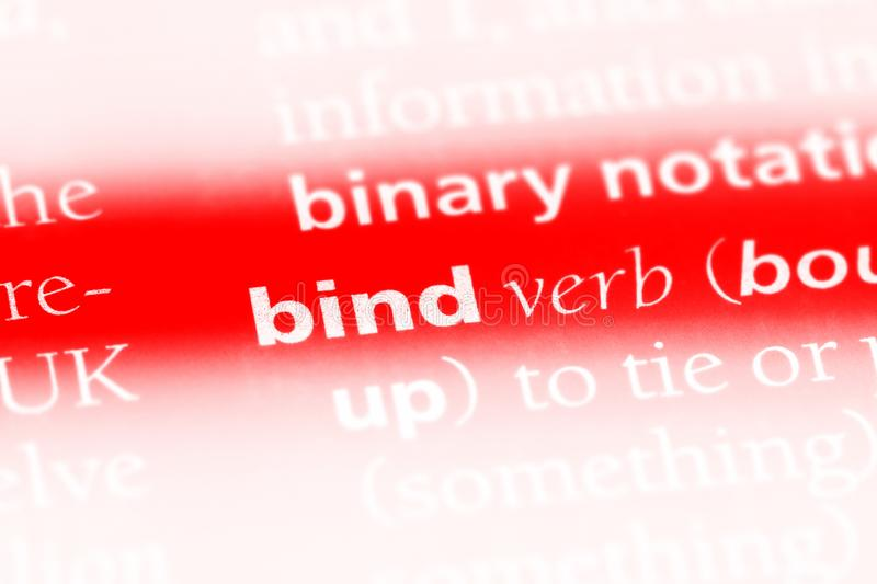 Bind. Word in a dictionary.  concept royalty free stock photo