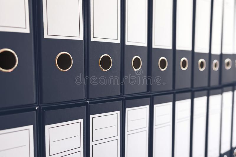 Binder folders in shelf, binders in a row. Business administration stock photography